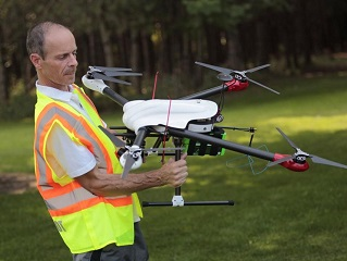 Marty watching his Drone from on top of his Mobile Ground Control Station, source CALS - Cornell University, Drone Tech Offers New Ways to Manage Climate Change