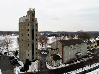 Pittsford Flour Mill, 11 Schoen Place, winter with dusting of snow