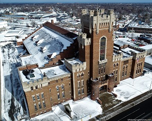 Main Street Armory, brickwork building, winter with dusting of snow